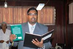 irfaan ali of babaa with his Koran