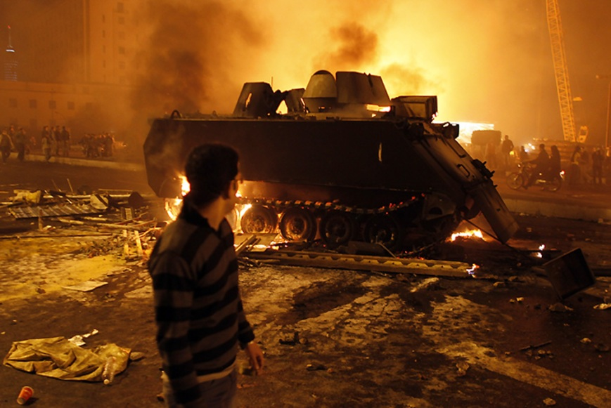 egyptians set armoured personnel carrier on fire