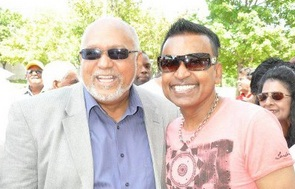 president of guyana and the baboo sharing a light moment