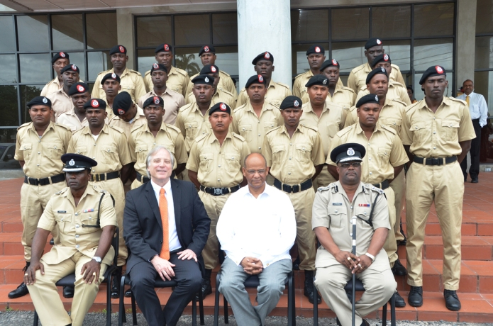 THE BOYS OF SWAT with Home Affairs Minister Clement Rohee (seated second right); FORMER Police Commissioner Leroy Brumell (right); TEG Director, Ambassador Dennis Hays (second left) and Training Officer, Senior Superintendent Paul Williams (left)