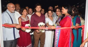 Leading Bollywood singer, Sonu Nigam, centre, cuts the ceremonial ribbon at yesterday's opening of the Bal Nivas centre in Akerville, Corentyne. Flanking him, from left, are President Donald Ramotar and First Lady Deolatchmee Ramotar. At far right is GHDS President, Dr. Vindhya Persaud
