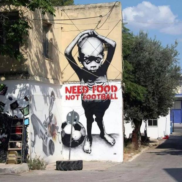 An Image in Brazil NEED FOOD NOT FOOTBALL.