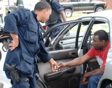 guyana police officeer accepting a bribe