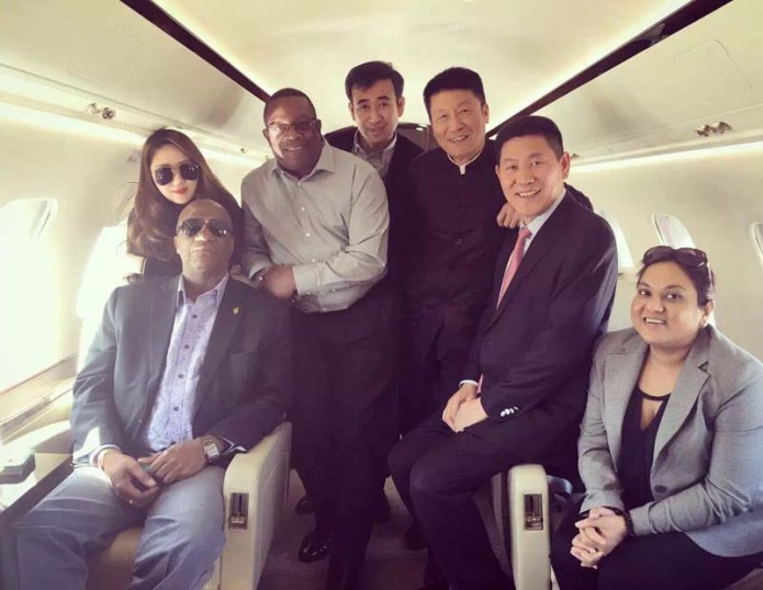 Joseph Harmon and the BaiShanLin's in a private jet in China